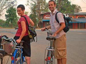 Two people standing by their bikes Myanmar