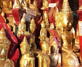 Golden statues in Pindaya caves Myanmar