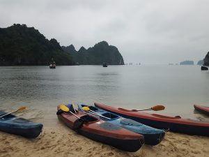 kayaks on beach in bai tu long bay vietnam