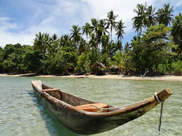 A boat floating near the beach in Boipeba, Brazil