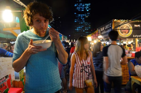 Man eating street food in Thailand