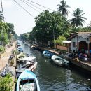 Boats and buildings along the river Negombo
