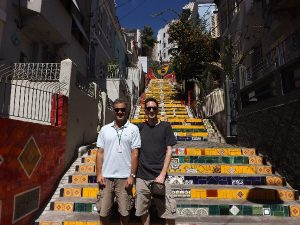 Two men by selaron Lapa steps Rio Brazil