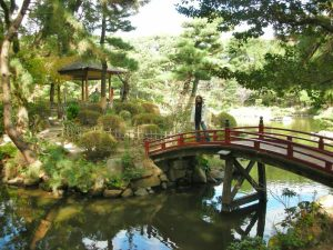 Lady on bridge in Shukkeien Garden Japan