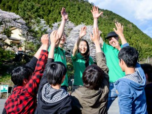 Children high fiving in Japan