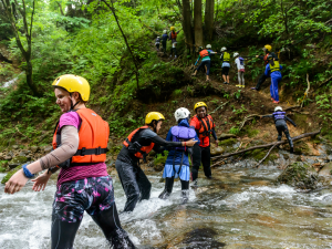 Group crossing a river in local project Japan