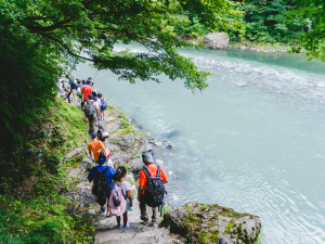 Group walking alongside river in Japan