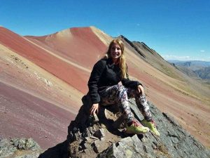 Customer trekking on Rainbow mountain in Peru