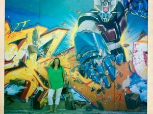 Woman standing in front of graffiti wall
