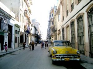 Yellow car on the street in Havana Cuba