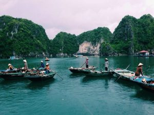 Vietnamese people in Halong Bay on boats