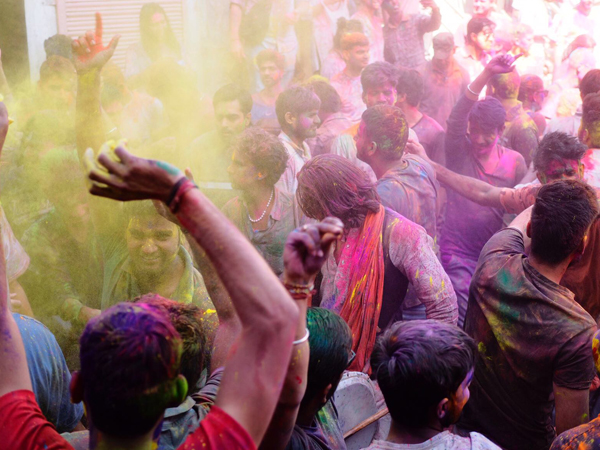 A crowd covered in colourful powder during Holi festival