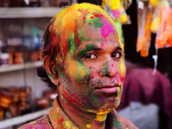 Man covered in colour powder