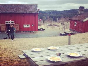 Eating food outside a Norwegian cabin