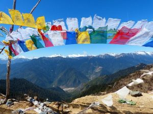 Colourful flags against the mountain landscape Bhutan