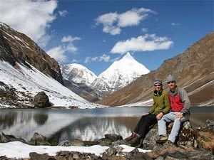 Customers infront of snowy mountain landscape Bhutan