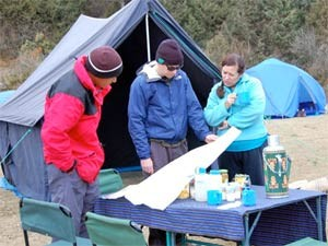 Customers planning their trek outside tent Bhutan