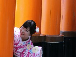 Japanese girl peeping out laughing Japan
