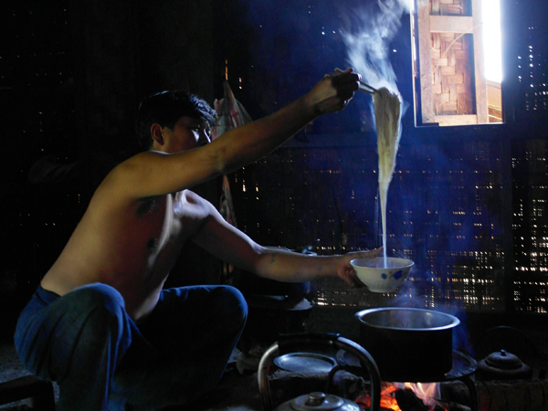Local man cooking shan noodles at home