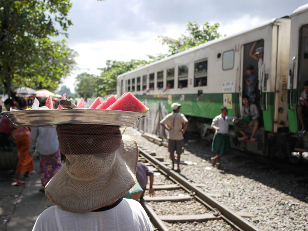 Locals hanging out outside a train in Myanmar