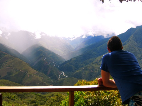 Man looking over Inca trail landscape Peru