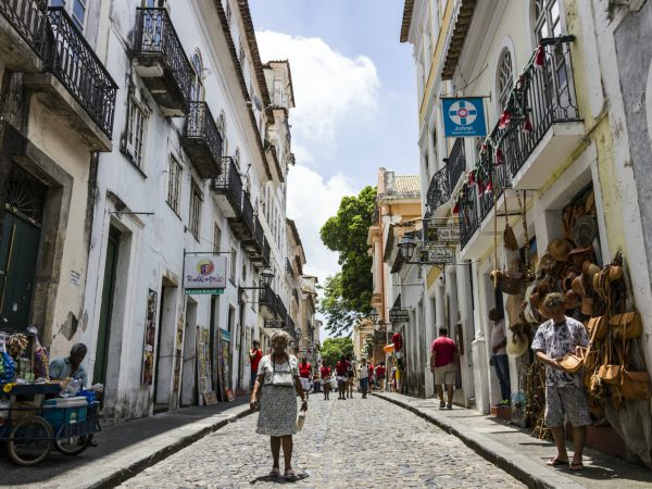 Local women standing on the cobbled streets of Salvador