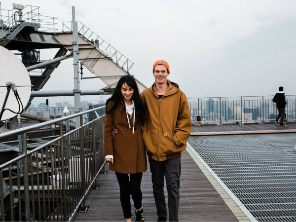 Man and a woman standing on walkway Japan