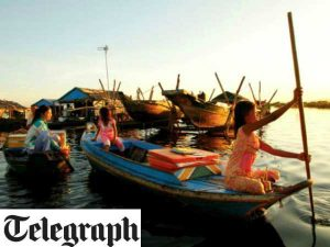 girls rowing boats in cambodia telegraph magazine