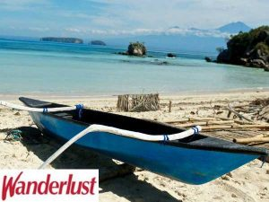 boat on the beach in indonesia wanderlust magazine