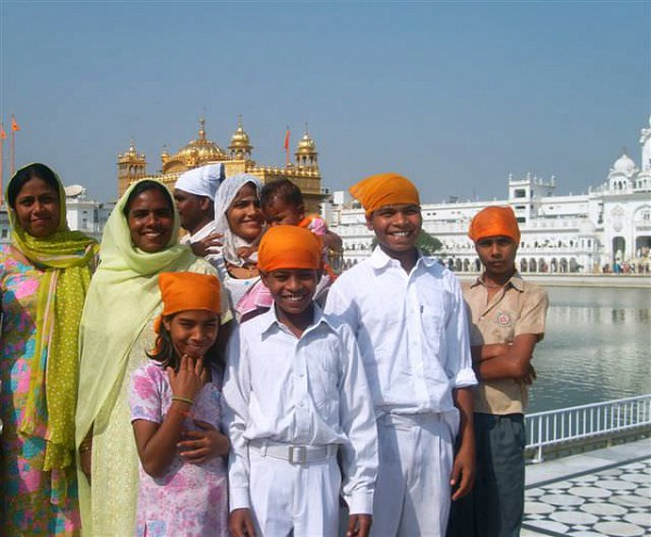 Family standing outside golden temple india