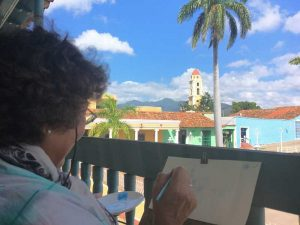 A woman painting in Trinidad, Cuba