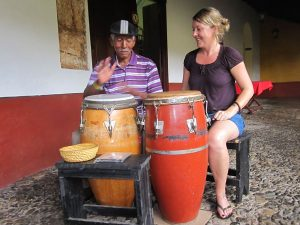 woman learning to play the drums in Cuba