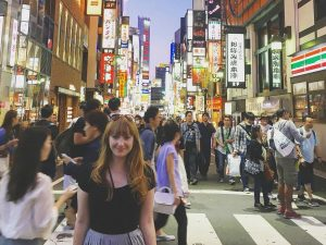 Woman standing in busy street Japan