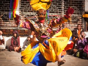 Locals dancing at Tsechu festival in Bhutan