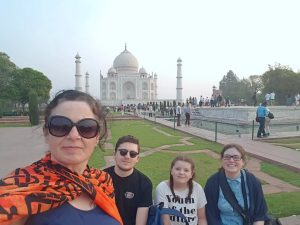 Family posing in front of Taj Mahal, India