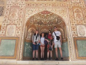 Family in India standing in front of Havali