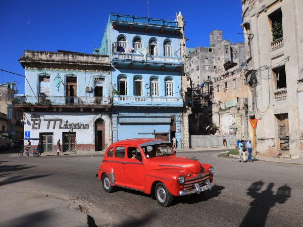 Red classic car in streets of Havana