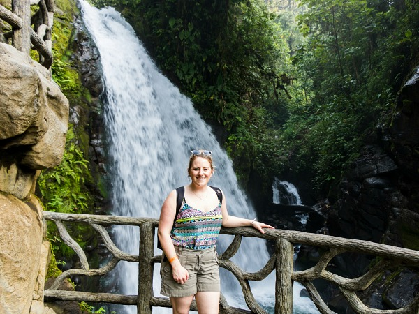Woman standing by waterfall Costa Rica