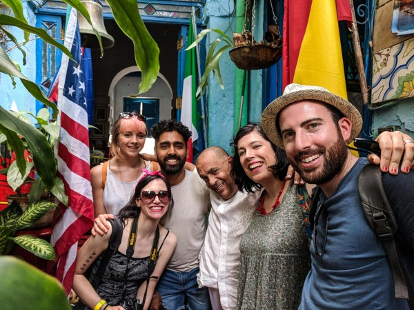 Rickshaw Staff smiling with arms round eachother
