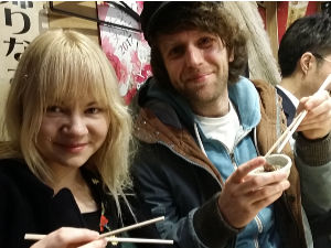 Couple in Shinjuku, Japan, enjoying local food