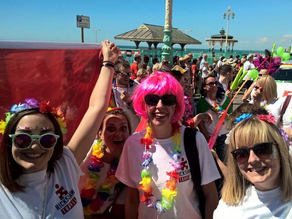 Rickshaw Team members at Brighton seafront marching