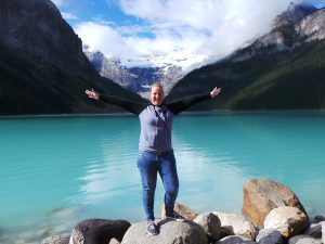 Customer posing infront of Lake Louise