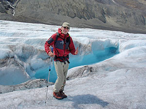 man on a glacier walk icefield parkway