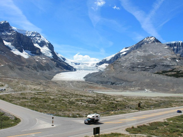 Roads with a car on and mountain backdrop