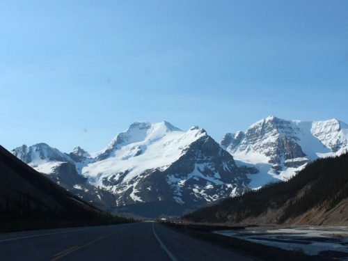 View of the road and snowcapped mountains