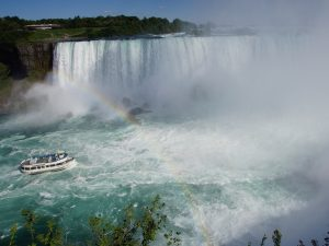Niagara Falls with boat and and a rainbow
