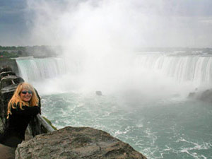 Women smiling with Niagara Falls in the background
