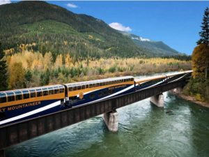 The Rocky Mountaineer train going through forests