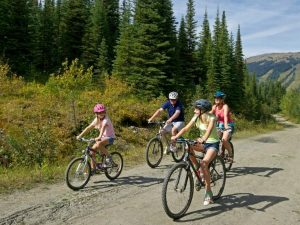 Family bike riding in Sun Peaks