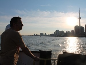 Man looking out at Toronto Skyline